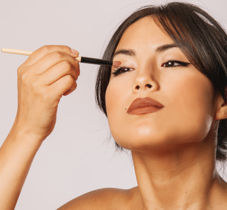 Asian woman doing make up and looking confident with double eyelid