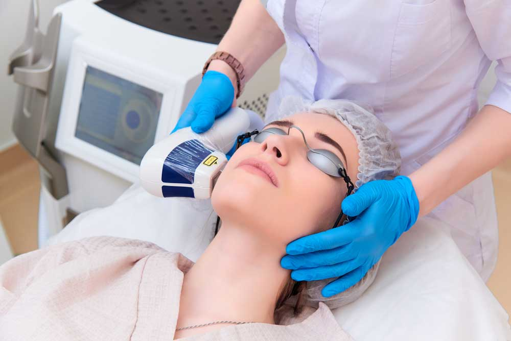 woman undergoes fractional laser treatment to fight off dark eye circle