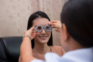 woman undergoing eye test with an eye care professional